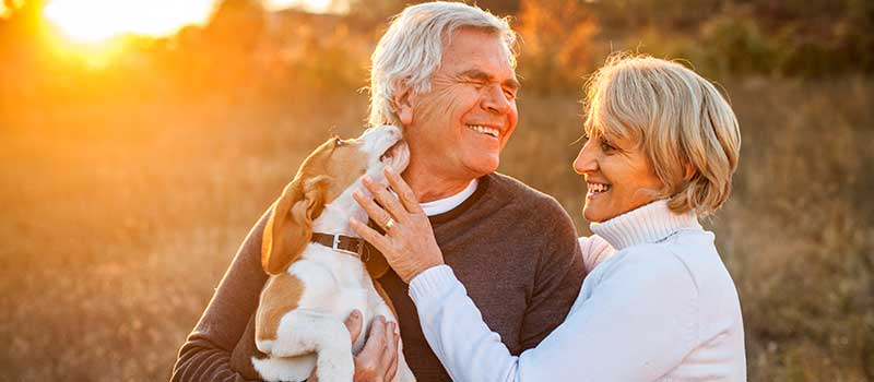 401(k) Retirees on Walk with Dog